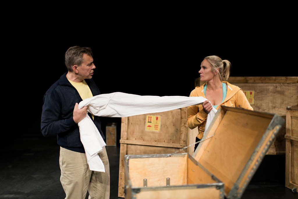 New neighbours (Pekka Valkeejärvi, left, and Laura Malmivaara) quarrel over the possession of old linen. Photo by Noora Geagea