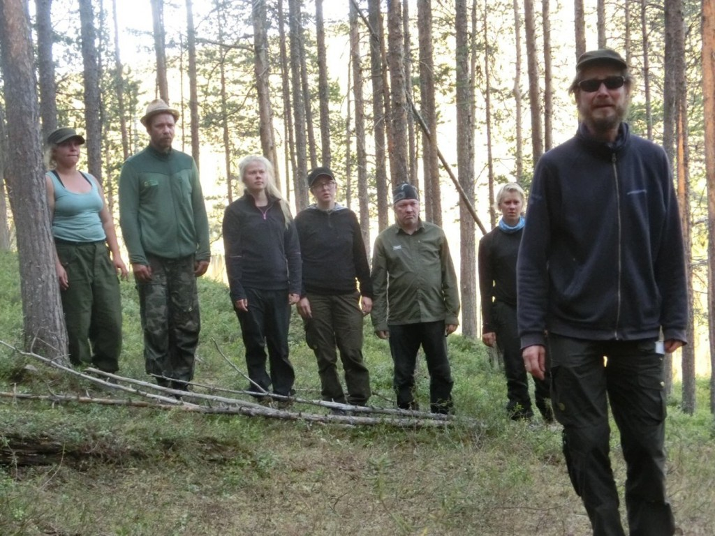 Juha Hurme (right) with his actors on stage in the forest in Lapland. Photo by Heino Ruuskanen