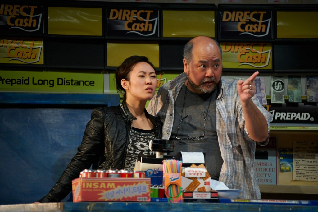 Chantelle Han as the daughter, Janet, receiving instructions from her father, Kim, (Paul Sun-Hyung Lee) in Kim's Convenience. Photo by Cylla von Tiedemann.