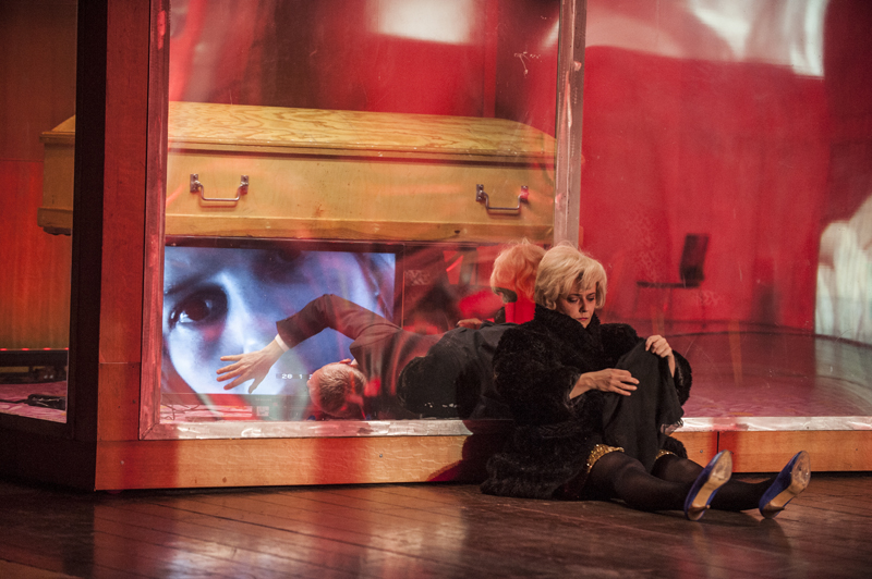 In Nowy Teatr's Polish production of (A) pollonia the stage was a wide industrial building subdivided into compartments with see-through walls and screens of varying sizes. Photo by Lucia Sekerkova