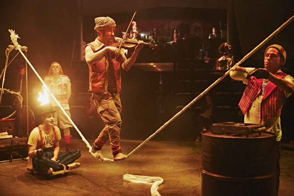 Performers play with danger and fire in a scene from Borders, a circus production with a strong message about freedom and immigration. Photo by Frans Hällqvist.