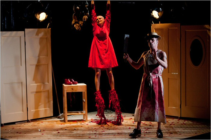 The severing of the feet. Kneehigh, The Red Shoes. Photo by Steve Tanner.